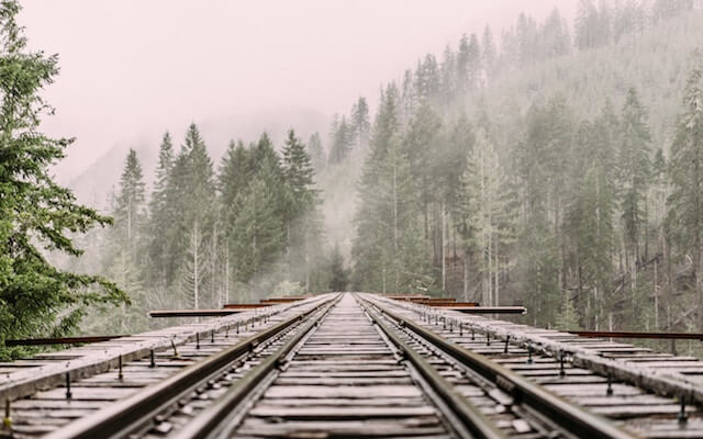 Picture of railroad tracks signifying when deciding how to plan an event the importance of staying focused.