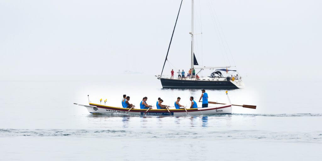 Picture of team in boat representing how important teamwork is when planning an event