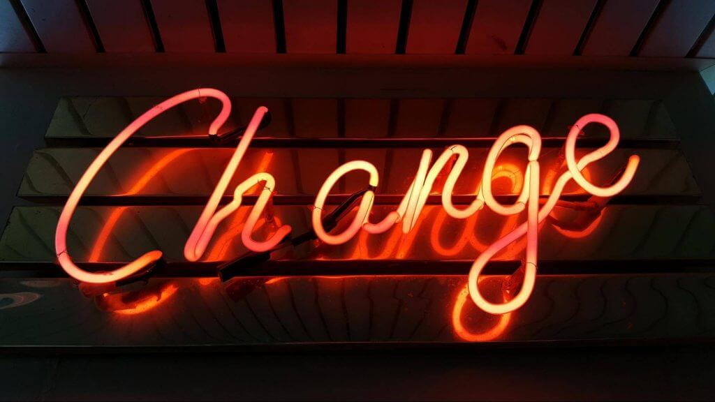 A neon sign saying change and referring to project management change